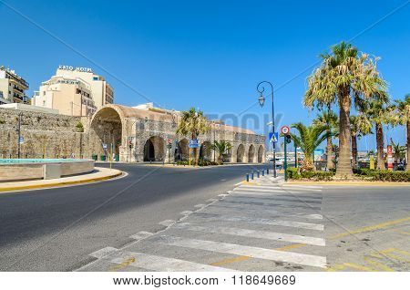 HERAKLION, CRETE, GREECE - AUGUST 11, 2015: View on Old ruins of warehouses in Heraklion old sea port.