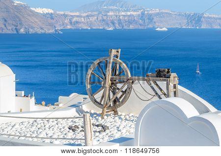 Spinning wheel  in the stunningly beautiful town of Oia, Santorini island, Greece