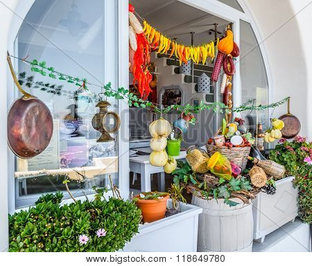 raditional Greek shop with different food and taverna in Thira town