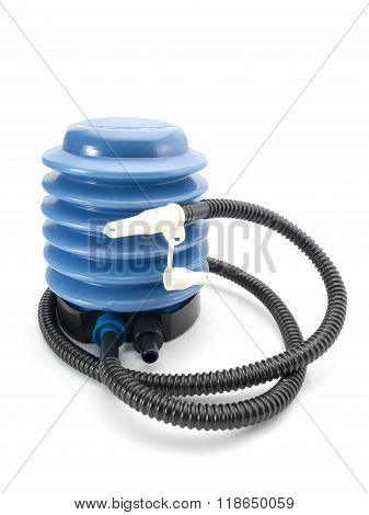 Blue air pump with pressure gauge on isolated white background