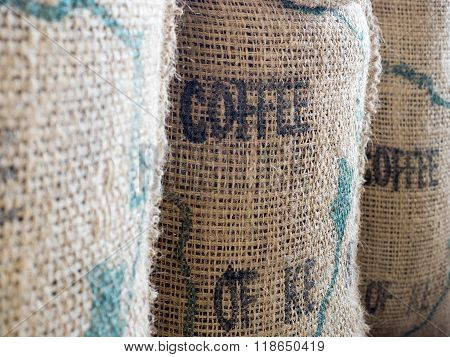 Close Up Of Textured Woven Hessian Fabric With The Word Coffee Stamped On It In A Coffee Background