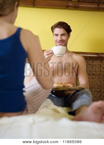 Young Couple Having Breakfast On Bed