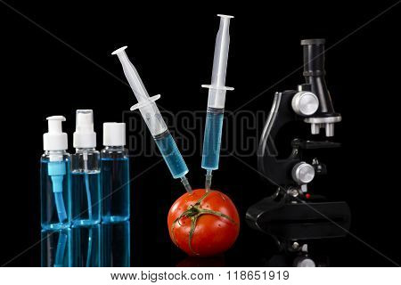 Genetically Modified Vegetables Tomato Vaccine On Black Background