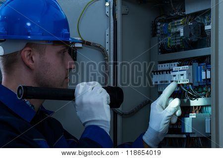 Male Technician Testing Fusebox