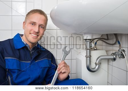 Smiling Worker Holding Wrench