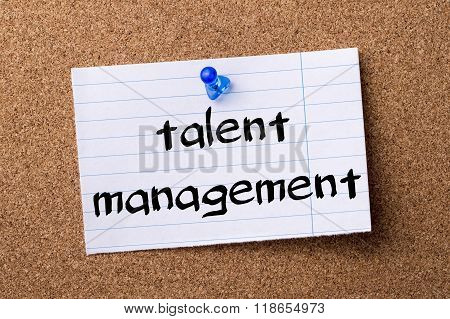 Talent Management - Teared Note Paper Pinned On Bulletin Board