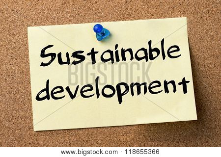 Sustainable Development - Adhesive Label Pinned On Bulletin Board