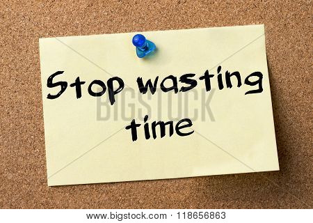 Stop Wasting Time - Adhesive Label Pinned On Bulletin Board