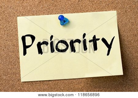 Priority - Adhesive Label Pinned On Bulletin Board