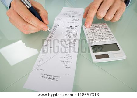 Person Hand Calculating Shopping Bill