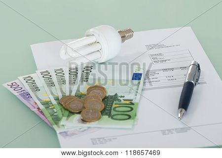 Fluorescent Light Bulb With Invoice And Currency