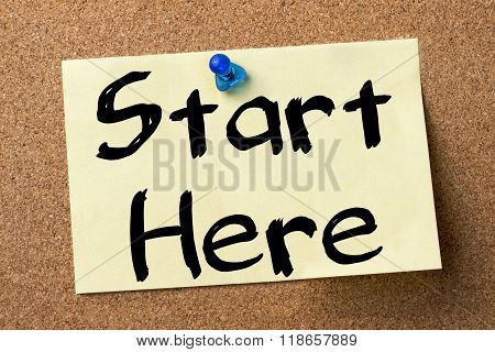 Start Here - Adhesive Label Pinned On Bulletin Board