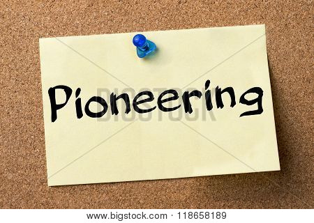 Pioneering - Adhesive Label Pinned On Bulletin Board