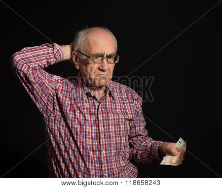 Elderly Man With Money