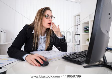 Shocked Businesswoman Looking At Computer