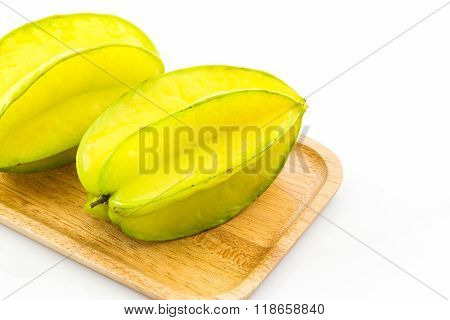 Star Fruit Or Carambola In Wooden Plates.