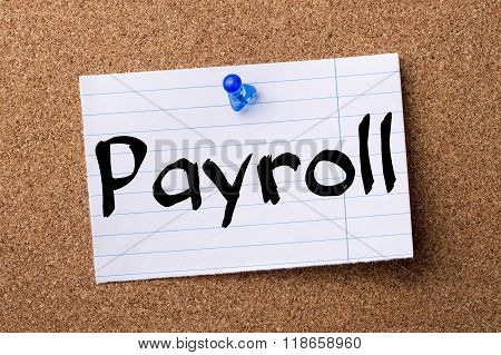 Payroll - Teared Note Paper Pinned On Bulletin Board