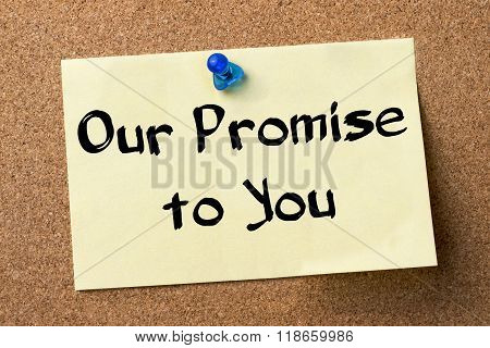Our Promise To You - Adhesive Label Pinned On Bulletin Board