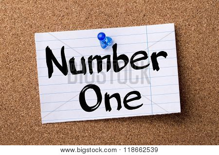 Number One - Teared Note Paper Pinned On Bulletin Board