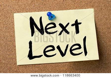 Next Level - Adhesive Label Pinned On Bulletin Board