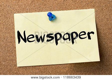 Newspaper - Adhesive Label Pinned On Bulletin Board