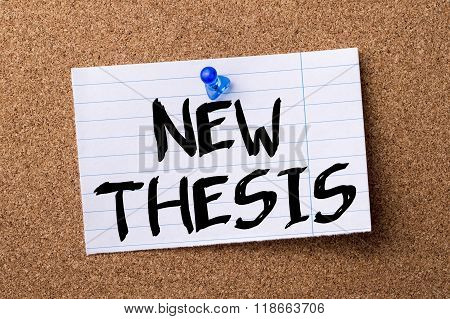 New Thesis - Teared Note Paper Pinned On Bulletin Board