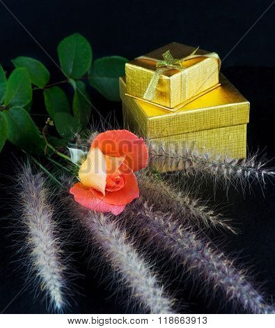 Red Rose And Golden Gift Boxes