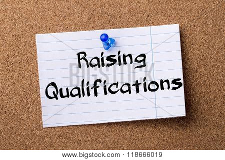 Raising Qualifications - Teared Note Paper Pinned On Bulletin Board