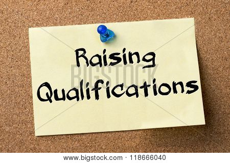 Raising Qualifications - Adhesive Label Pinned On Bulletin Board