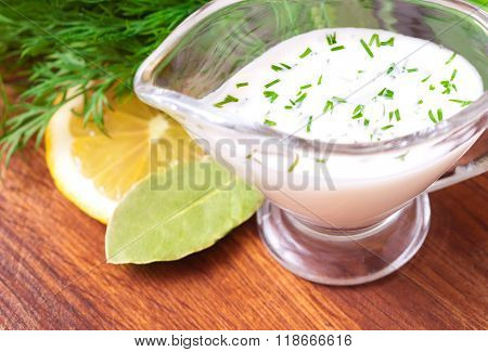 Creamy Sauce With Herbs On A Table