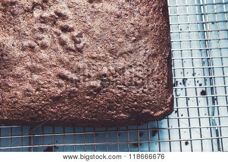 Close Up Overhead Of Chocolate Brownie Cake On Wire Rack
