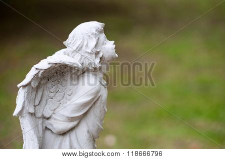 Angel Statue In Nature Place In Soft Light
