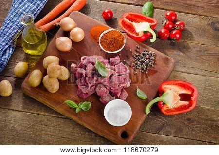 Ingredients For Stew Or Goulash  On Cutting Board.