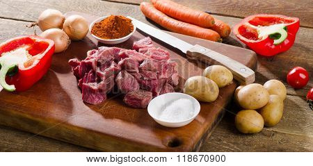 Ingredients For Goulash  On A Wooden Table.