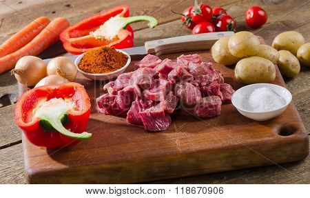 Ingredients For Goulash  On A Rustic Wooden Table.