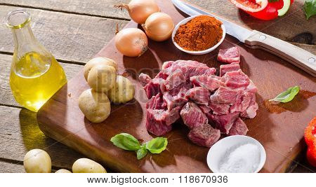 Ingredients For Goulash  On Wooden Table.