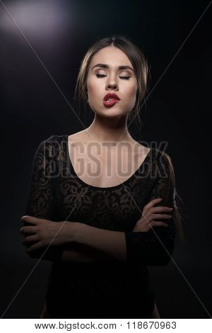 Brunette with sexy lips dressed in erotic bodysuit