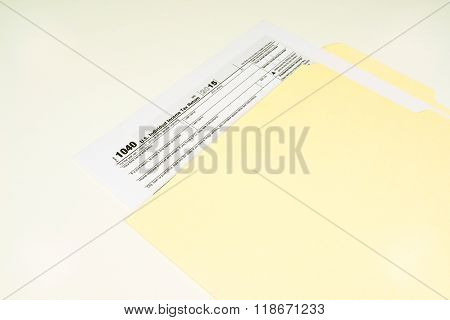 Tax Form 1040 on Light Background
