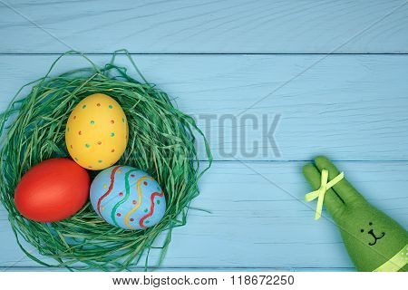Easter eggs hand painted, rabbit, wood background
