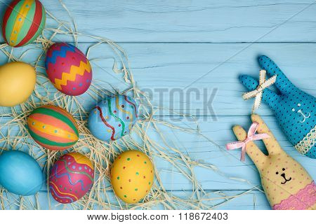 Easter eggs hand painted, rabbits, wood background