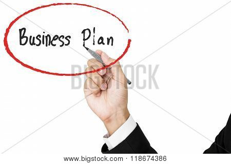 Businessman hand writing business plan, isolated on white background