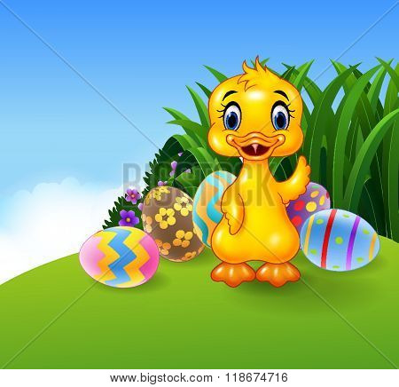 Cute little duck with colourful Easter eggs