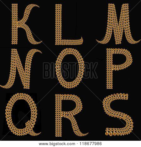 Gold Alphabet Letters Uppercase K - S On Black Background Isolated.