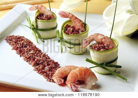 Appetizer Of Red Rice With Prawns And Zucchini