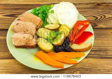 Healthy Food, Sliced Pork Meat With Stewed Various Vegetables In Plate On Wooden Background