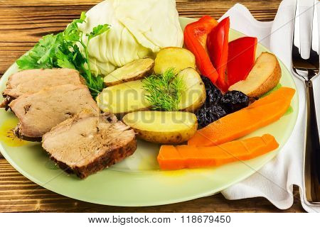 Healthy Food, Sliced Pork Meat With Stewed Various Vegetables In Plate, Fork On Napkin, Wooden Backg