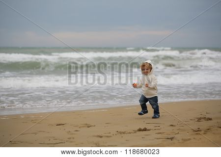 Joyful Boy Running At Beach