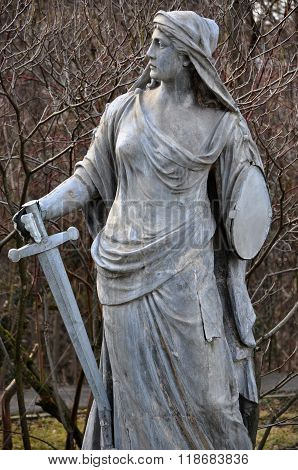 Statue Of A Roman Goddess With A Sword
