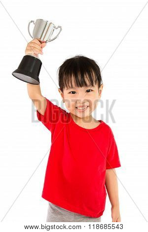 Asian Little Chinese Girl Smiles With A Trophy In Her Hands