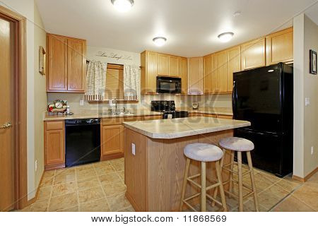 Light Color Kitchen With Black Appliances